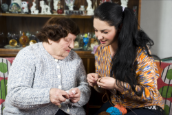 lady and old woman sewing